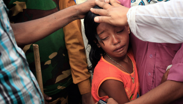 A girl cries at collapsed Dhaka clothes factory